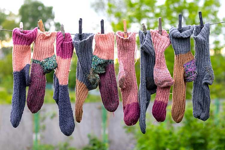 socks hanging on a line to dry