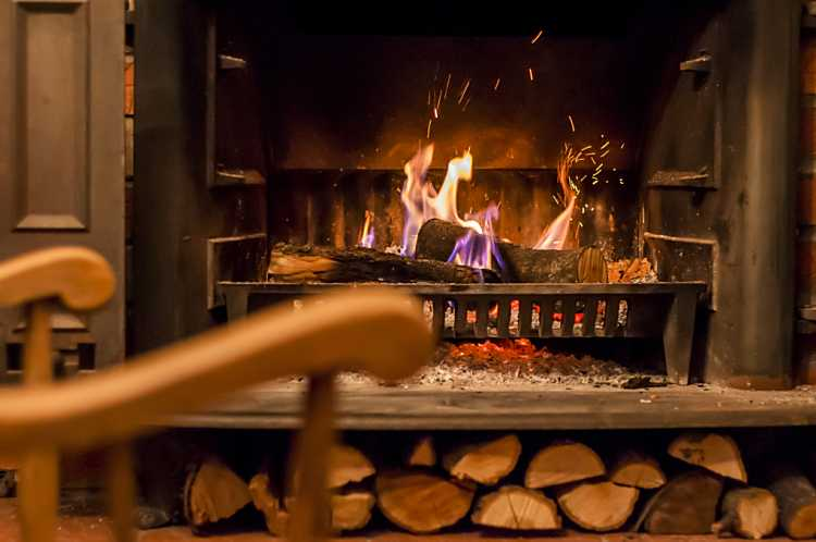 a fireplace with burning logs
