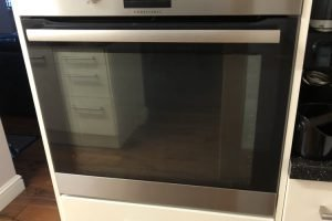 front of oven