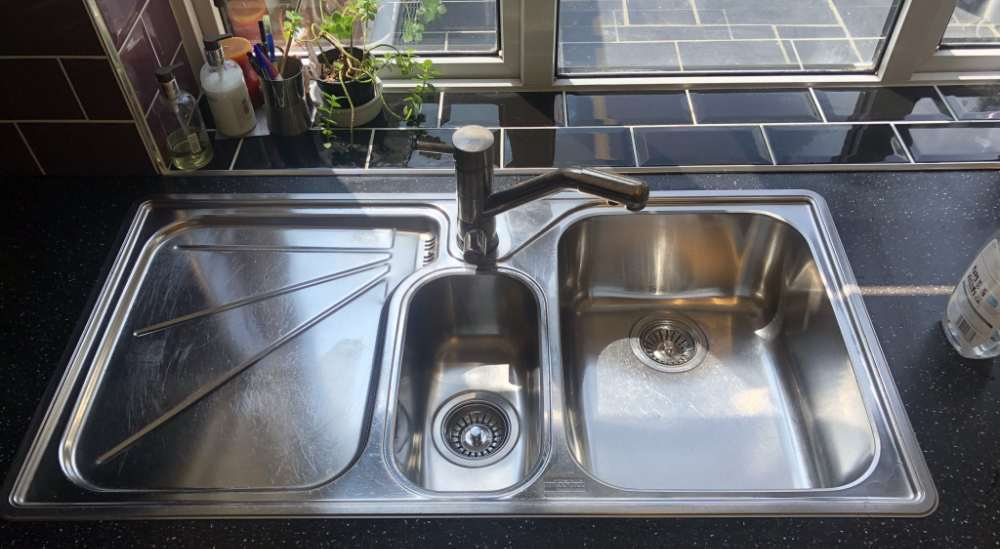gleaming stainless steel sink