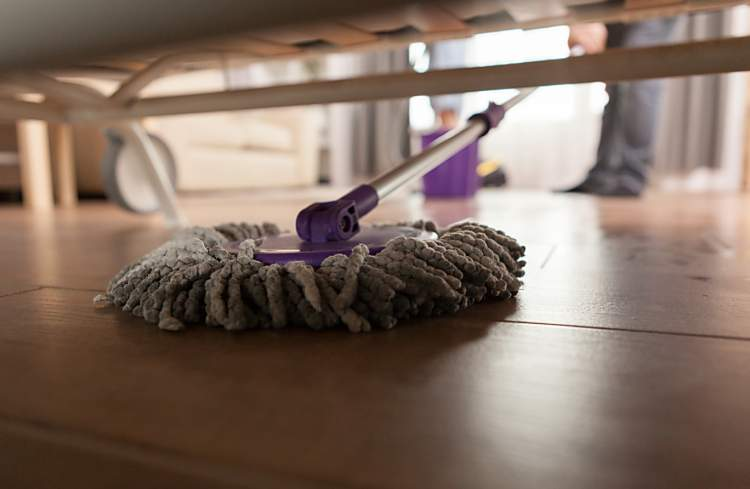 dusting under a bed