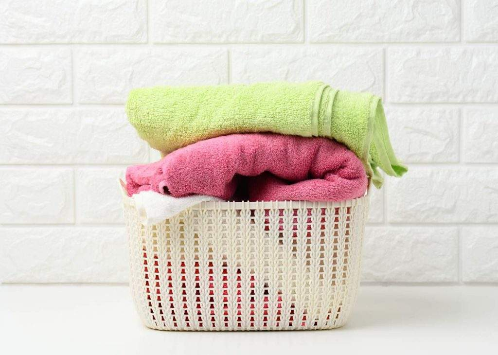 clean towels in a laundry basket